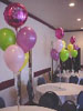 "Your average balloon bouquets can easily be morphed into something more appealing by adding a printed 18"" mylar balloon. Here, the table decorations were enhanced greatly while maintaining the overall colour theme. Montreal's Pret-A-Party decorations"