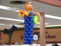Unique and eye-catching decorations are the objective for those who opt for this funtastic scarecrow balloon sculpture, complete with straw hat, raffia and bandana accents, from Montreal's Pret-A-Party
