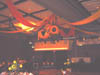 Sunflower tropical ceiling decor with vinyl swags above the dance floor of the reception hall