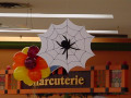 Spider web cut-out with a shadowy spider imprint, suspended for that creepy Halloween effect, from Montreal's Pret-A-Party